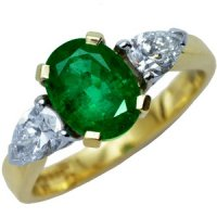 Oval Emerald and Diamond Trilogy Dress Ring. 18ct Gold.