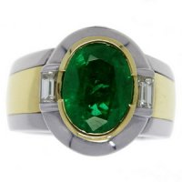A Contemporary Oval Emerald and Diamond single stone ring.