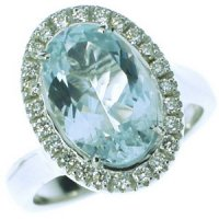 A Stunning Oval Aquamarine and Diamond Cluster Ring. 18k Gold.