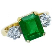 Diamond & Emerald Three Stone Ring. A fine Emerald cut Emerald.
