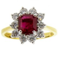 A Traditional Octagon Ruby and Diamond Cluster Ring. 18K.