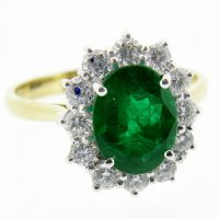 18k gold Columbian Emerald Ring set with Diamonds as a Cluster.